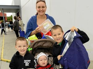 Kea McCarthy of Tanah Merah with her sons, Zac, 4, Jonah, 1, and Maxim, 6, with free food provided the Tribe of Judah Care that helps many families in Logan.