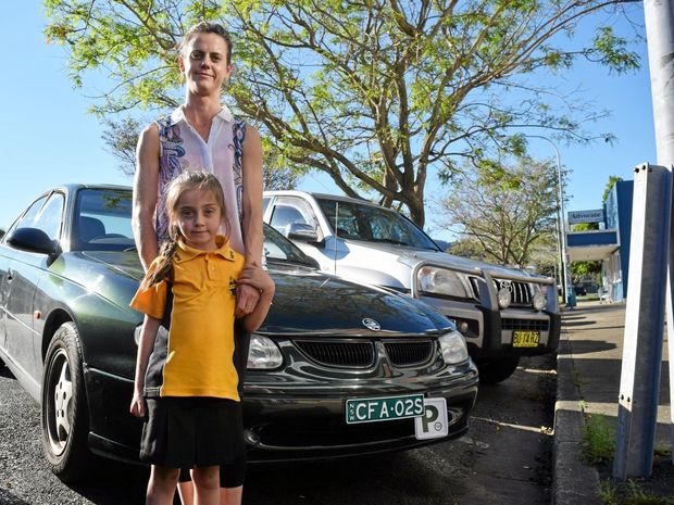 CLOSE CALL: Terrie Maryvale, with daughter Maddison, are appealing for witnesses after an alleged hit and run on the Pacific Hwy .