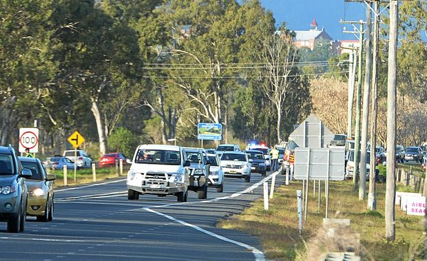 Traffic backs up on the Capricorn Highway between Rockhampton and Gracemere after a car crashed into a power pole.   Photo: Chris Ison / The Morning Bulletin