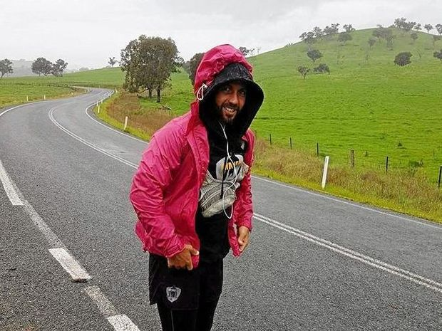 Jamie Milne is battling the rain and extreme cold on Day Five of his 2000km run from Melbourne to Warana to support dementia research.