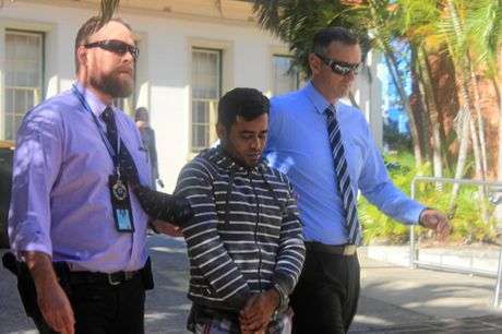 Man arrested in relation to the murder of Syeid Alam escorted from the Rockhampton Police Station to watch house at the Rockhampton Courthouse.