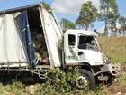 A truck has reportedly rolled on the Bruce Hwy.