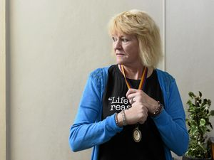 Michelle Manning hangs on to the medal her daughter Nyree won in rowing at a previous transplant games. Michelle and her son are going back to the games representing a donor family after donating Nyree's organs after her death.