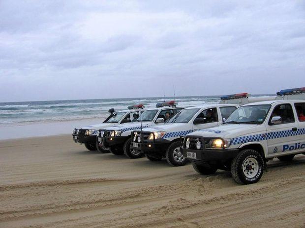 BEACH PATROL: Local police on the beach beat.