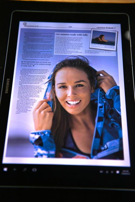 Julia Whitwell tries out the Sunshine Coast Daily App. Photo: John McCutcheon / Sunshine Coast Daily