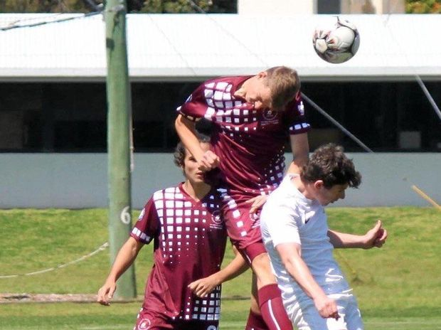 COMPETITIVE: Thomas Mewes (centre) in action for Queensland at the 2015 national titles.