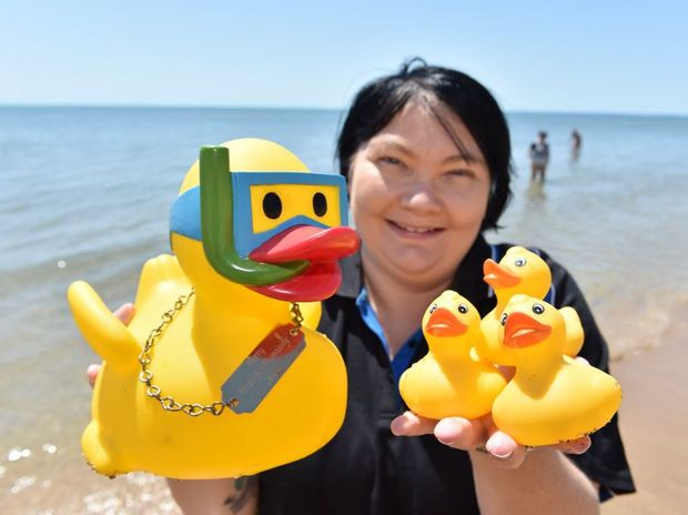 The 2016 Great Fraser Coast Duck Race - Amanda Edwards with head duck Harry and three of the 500 racing ducks.