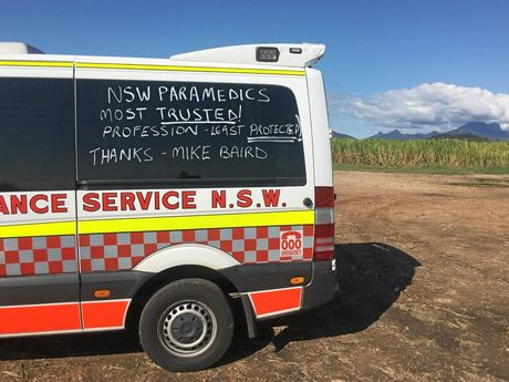Local paramedics taking part in the death and disability liquid chalk campaign with Mt Warning in the background.