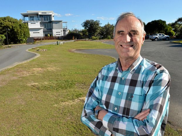North Shore Village body corporate chairman Clive Shepherd can afford to smile after fighting off a 124-unit development approved by Sunshine Coast Council which would have been situated on the land he is standing on.