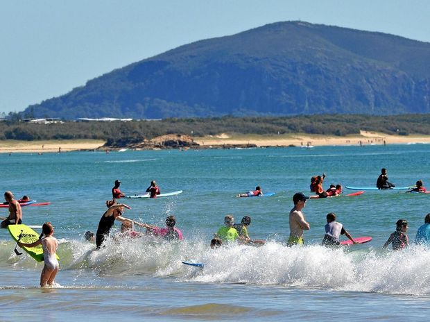Just another perfect beach holiday scene at Alexandra Headland with Mount Coolum looming in the background.