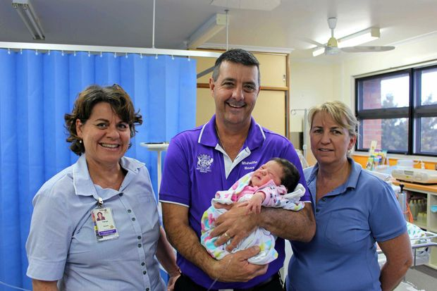 NEW DELIVERY: Warwick Hospital midwives (from left) Tanya Ogden, Ross Newton and Kerry Roche,with baby Lacey Wotton, celebrate the Warwick Hospital's recent Baby Friendly Health Initiativeaccreditation.