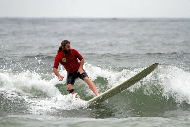CARVING UP: Nigel O'Neil riding the waves at Turners Beach for the Al Richards Memorial.
