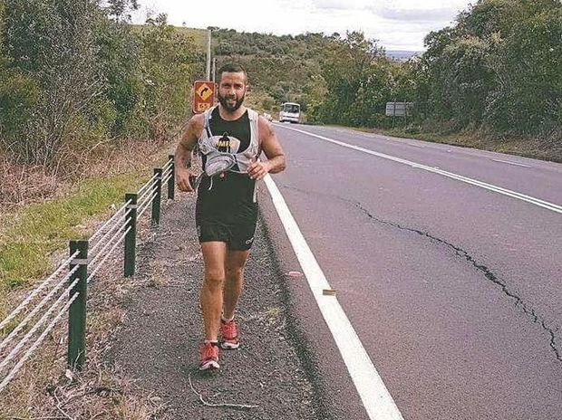 Jamie Milne feeling the pressure as he makes his way through rolling hills near Picton on his way to Liverpool in Sydney.