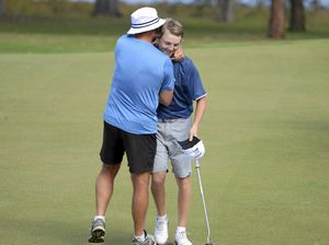 Lucas Higgins gets a hug off his dad after winning the NSW OPEN Regional Golf Qualifier at the Grafton Golf course on Sunday, 25th September, 2016. Photo Debrah Novak / The Daily Examiner