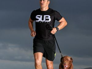 CHALLENGE: Tweed Shire Council candidate James Owen with his best mate having a jog on Salt Beach.