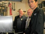 R-L: are Jez, Rocky Resort Motor Inn Manager Don McLeod and CQUni Chef Teacher Tim Wade.