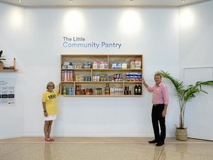 A BIG HELP: Noosa Civic centre manager Brian Turner and REAP Sunshine Coast chapter co-ordinator Michelle Lipner at the new Little Community Pantry.