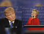 Republican presidential nominee Donald Trump listens to Democratic presidential nominee Hillary Clinton during the presidential debate