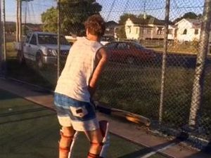 Jack Fletcher shows his batting style