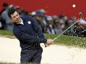 Europe's Rory McIlroy hits from a bunker on the eighth hole during a practice round for the Ryder Cup at Hazeltine National Golf Club in Chaska, Minnesota.