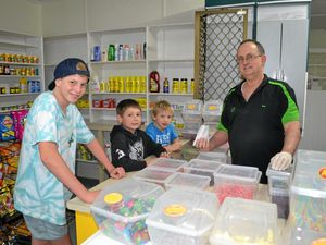 CLOSING DOWN: Denver Hart, Benjamin Hartin and Brayden Bevan buy some sweets from Bob Riley.