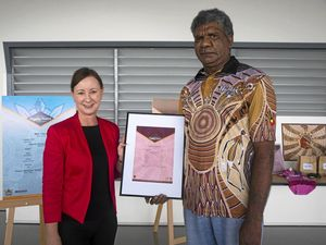 Attorney-General Yvette D'Ath with Cherbourg artist Charlie Chambers.