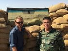 FORMER Longman MP Wyatt Roy has been caught in a firefight near the border of Syria and Iraq.