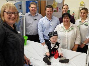 Cheryl Comens, Tony Quinn, Hadley Monckton, Mar Donnelly-Wells, Rachael Groves and Ruth Powell visit Zander Da Pra during their visit to the children's ward.