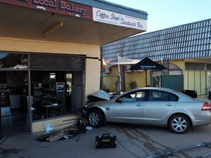 The scene after a car crashed into a bakery after the elderly driver suffered a medical episode.