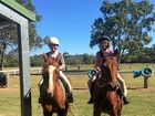 HORSING AROUND: Abbi Briggs and Eliza Piper get a confidence boost out of pony club.
