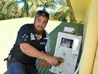 WORKING: Ben Petersen of Buderim Air installing air conditioners ahead of summer.
