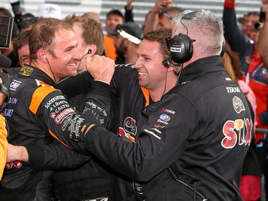 KING OF THE MOUNTAIN: Holden driver Will Davison (left) of the Tekno Autosports team celebrates with his crew after winning the Bathurst 1000.