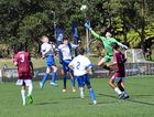 The Queensland Metro keeper tries to clear away a corner kick while Capital Football strikers look for a scoring opportunity in the FFA National Youth Championships for Boys at C.ex Coffs International Stadium. 4 October 2016 Photo: Brad Greenshields/Coffs Coast Advocate
