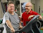 SECOND CHANCE: Jim Tomlinson has lost huge amount of weight and turned his life around with the help of staff, like Steve Bartlett, senior exercise physiologist, at the Ipswich Chronic Conditions Service.
