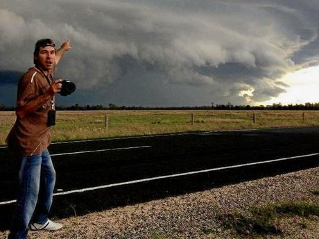 Jeff Higgins, of Higgins Storm Chasing, with camera at the ready as storm clouds loom.