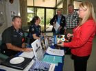 Volunteer in Policing Graham Gibb with acting sergeant Clair Parsons informing attendees of dementia awareness and safety in the home as well as handing out the Little Book of Scams. Photo Kyle Zenchyson / Caboolture News