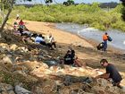 About 30 volunteers were at a beach near Slade Point Rd this morning cleaning up styrofoam ballsPhoto Troy Kippen / Daily Mercury