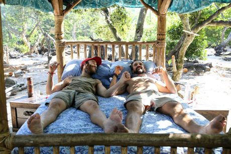 Australian Survivor contestants Sam Webb and Lee Carseldine enjoy the comfort of a bed after winning a challenge.