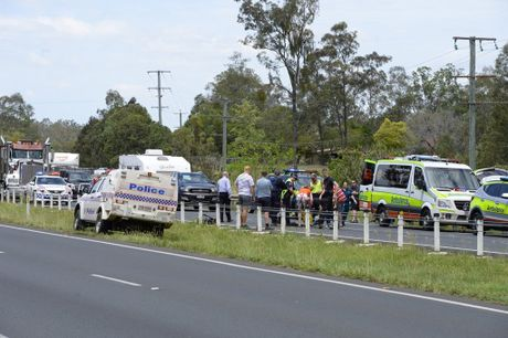 Emergency services at the scene of a motorcycle crash on the west-bound lanes of the Warrego Hwy at Blacksoil.