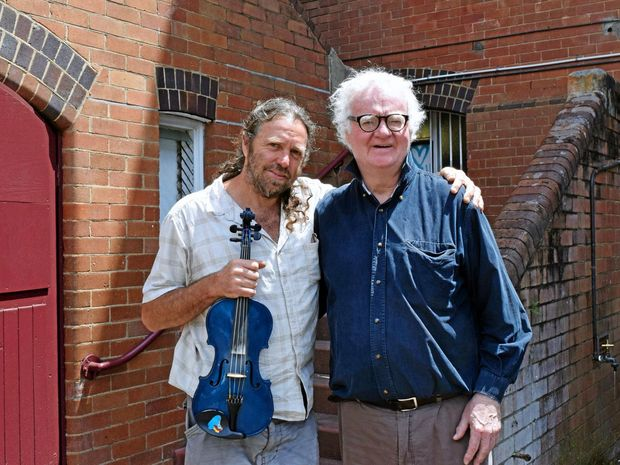 Composer Mark Bromley and conductor, Richard Gill, outside the historic building that houses the Norther Rivers Conservatorium in Lismore.