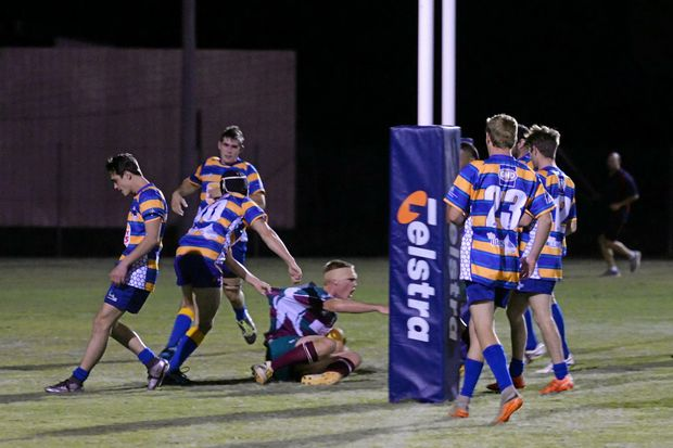 POINTS: Isis Crushers player Jake Bauer celebrates after scoring a try against The Waves Falcons.