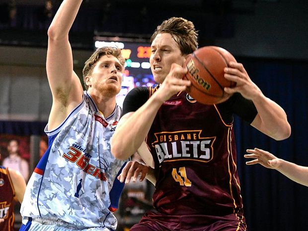 Cameron Bairstow of the Bullets (right) played his first game after a dislocated shoulder.