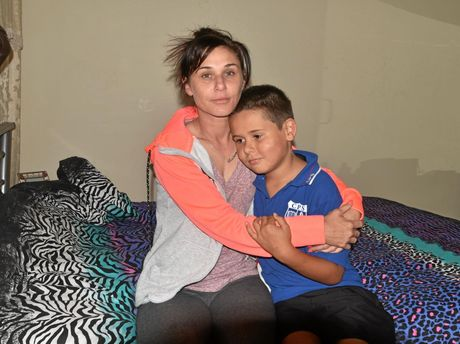 Single mum Lucinda Sutherland with younger son Jhakai Williams, 9 in the room where an intruder was found under her bed.
