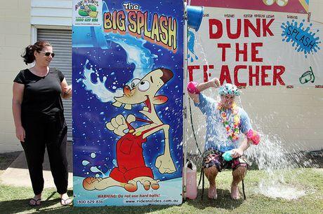 Year 6 teacher Brad Turner gets dunked.