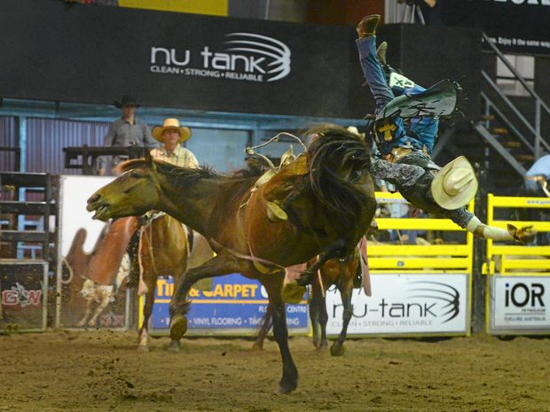 Chris Woodward gets tossed off his horse in the bareback event on Saturday.