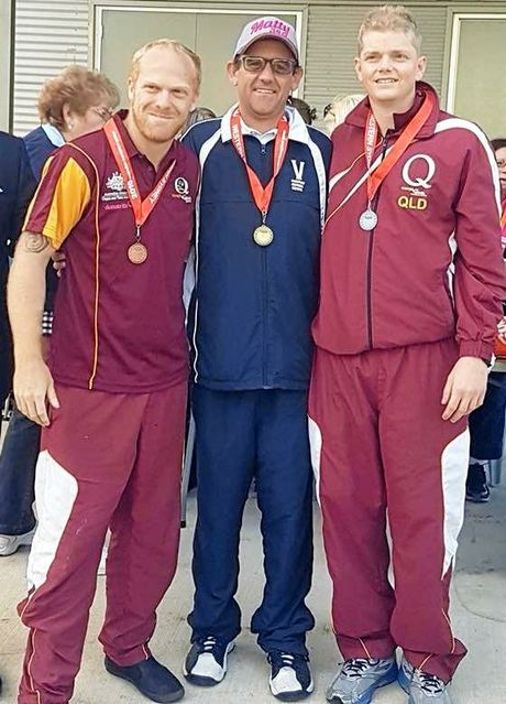 MEDALLIST: Toowoomba's Aaron Williams (left) with one of his medals at the Australian Transplant Games.