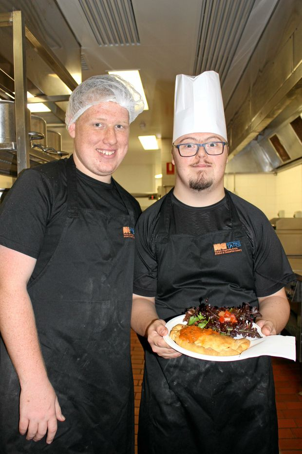 COOKING UP SUCCESS: Jason Williams and Robert Porteous with one of their creations.