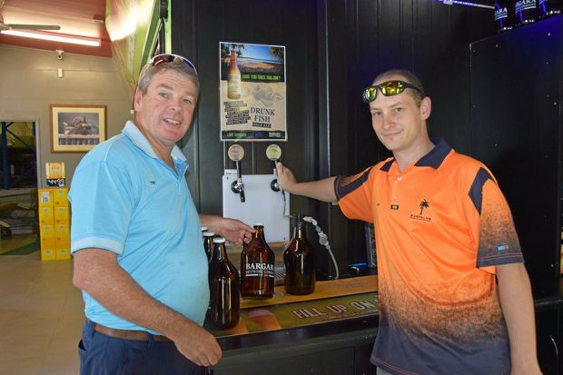 Tim Pleming and Jimi Callahan show off their boutique beer on tap.
