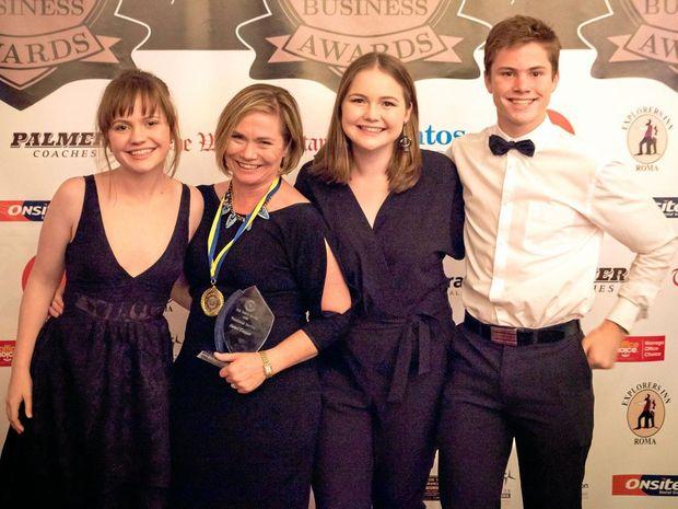 JOB WELL DONE: Carmel Treasure celebrates winning Rotary Roma's Jim Baker Medal with children Bridget, Georgia and Gerard.