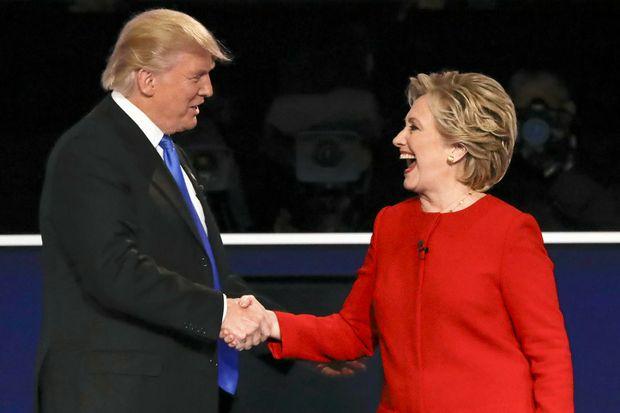 Republican presidential nominee Donald Trump shakes hands with Democratic presidential nominee Hillary Clinton after a presidential debate.